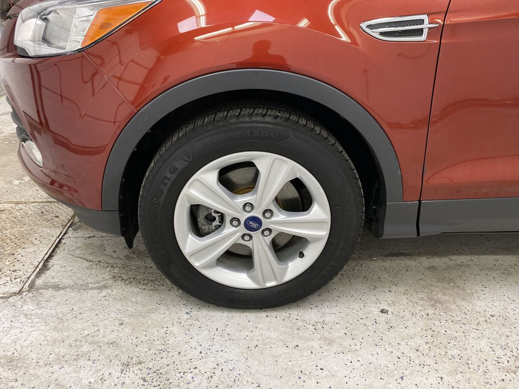 Orange[Sunset] 2014 Ford Escape Left Front Rim and Tire Photo in Dartmouth NS