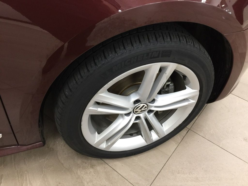 Red[Opera Red Metallic] 2012 Volkswagen Passat TDI Highline Right Front Rim and Tire Photo in Sherwood Park AB