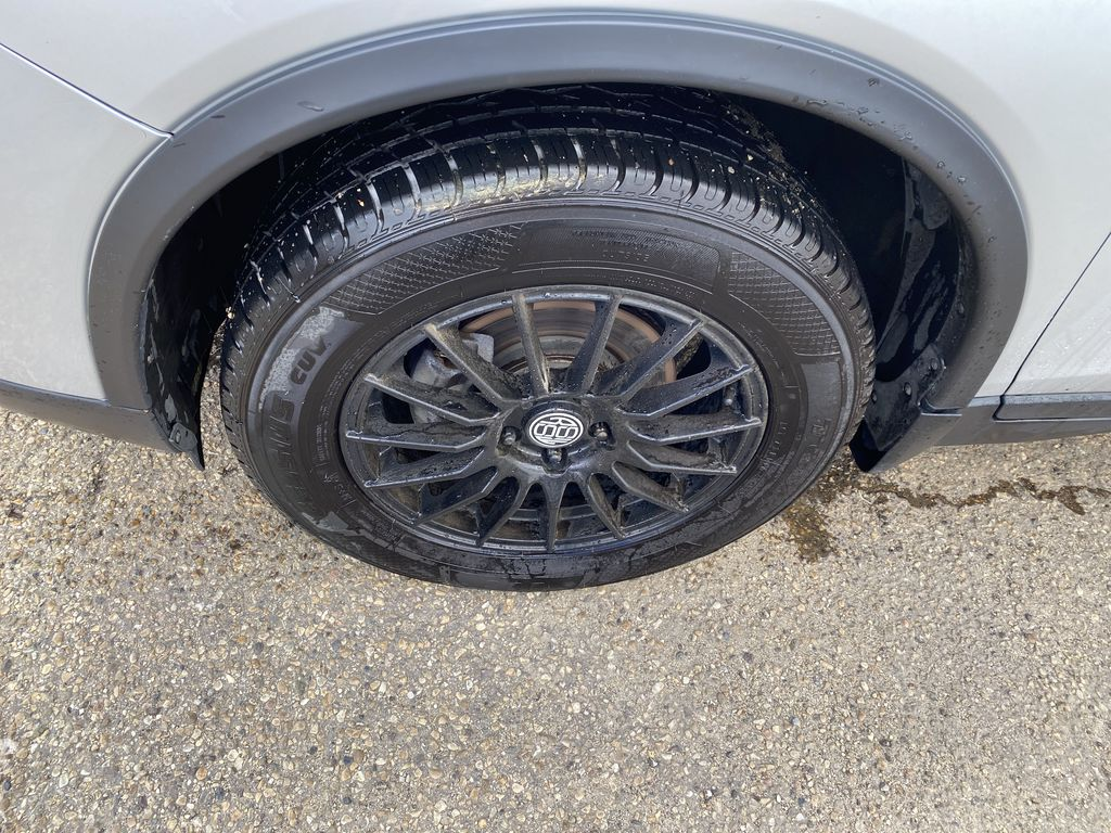 SILVER 2014 Nissan Rogue S AWD - Bluetooth, Backup Cam, Steering Wheel Controls Left Front Rim and Tire Photo in Edmonton AB