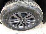 Black[Onyx Black] 2020 GMC Canyon SLE Left Front Rim and Tire Photo in Canmore AB