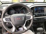 Black[Onyx Black] 2020 GMC Canyon SLE Steering Wheel and Dash Photo in Canmore AB