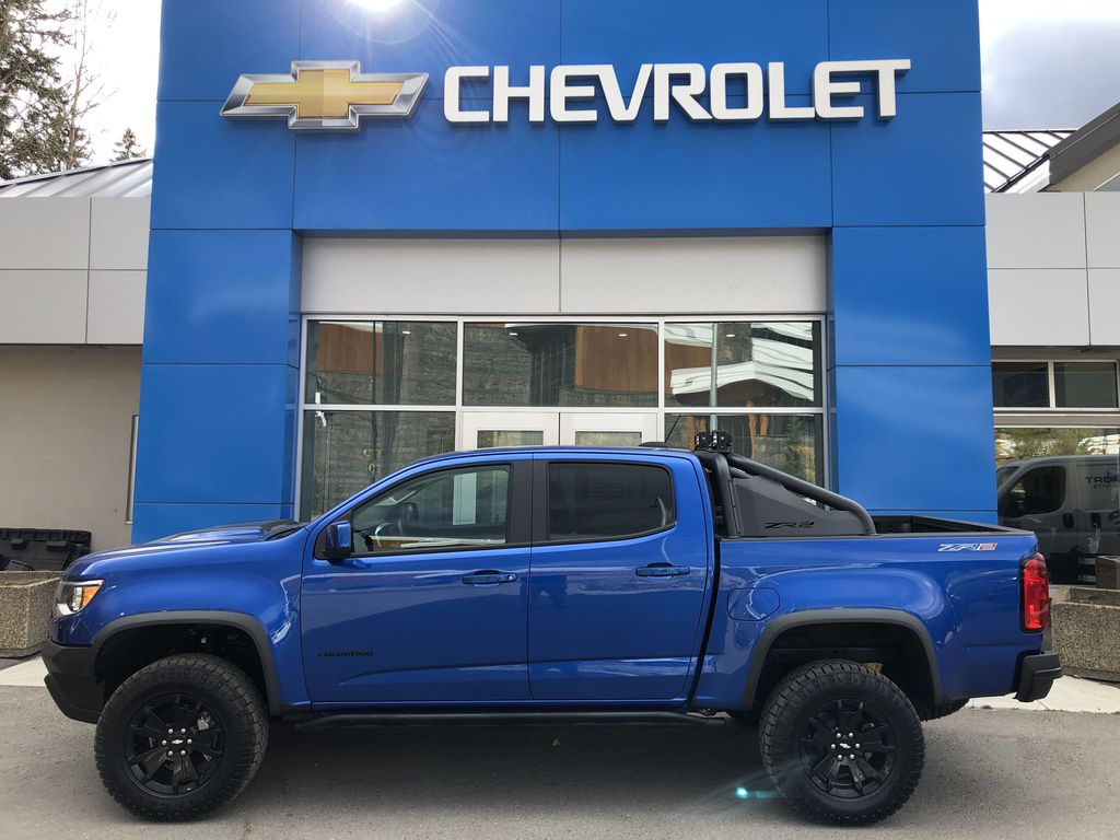 Blue[Kinetic Blue Metallic] 2020 Chevrolet Colorado ZR2 Left Side Photo in Canmore AB