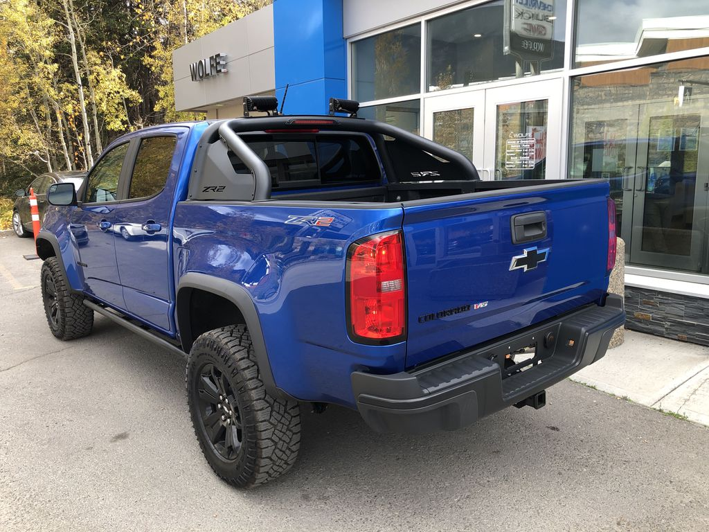 Blue[Kinetic Blue Metallic] 2020 Chevrolet Colorado ZR2 Left Rear Corner Photo in Canmore AB