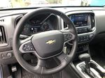 Blue[Kinetic Blue Metallic] 2020 Chevrolet Colorado ZR2 Steering Wheel and Dash Photo in Canmore AB