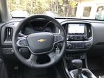 Blue[Kinetic Blue Metallic] 2020 Chevrolet Colorado ZR2 Strng Wheel/Dash Photo: Frm Rear in Canmore AB