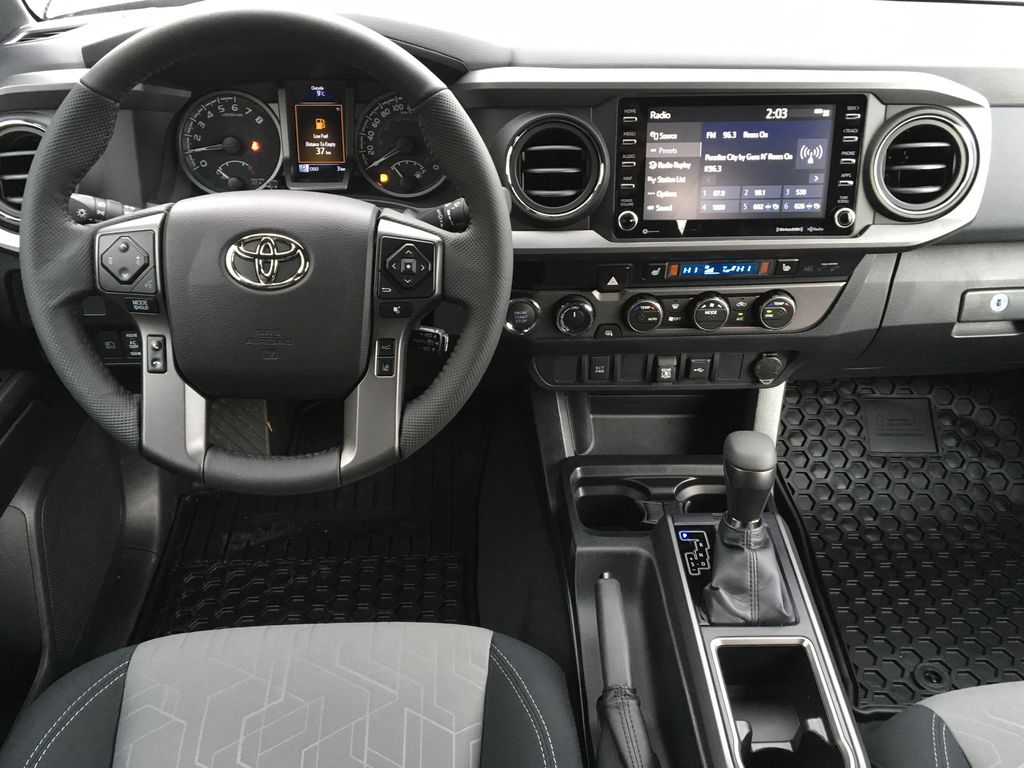 Magnetic Grey Metallic 2021 Toyota Tacoma TRD Sport Steering Wheel and Dash Photo in Kelowna BC
