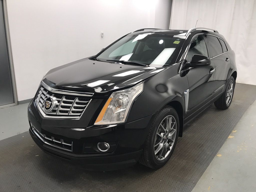 Black 2015 Cadillac SRX Left Front Head Light / Bumper and Grill in Lethbridge AB