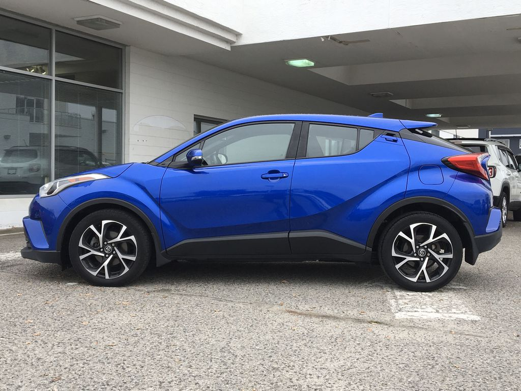 Blue Eclipse Metallic 2018 Toyota C-HR Left Side Photo in Kelowna BC