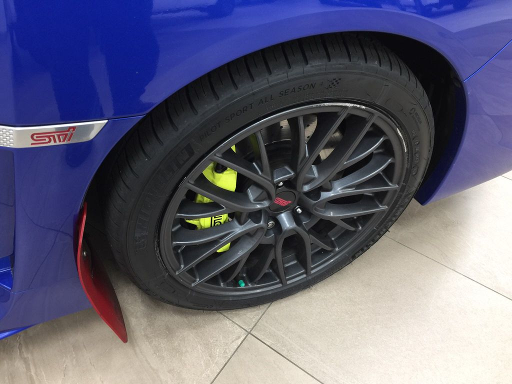 Blue[World Rally Blue Pearl] 2018 Subaru WRX STI AWD Right Front Rim and Tire Photo in Sherwood Park AB