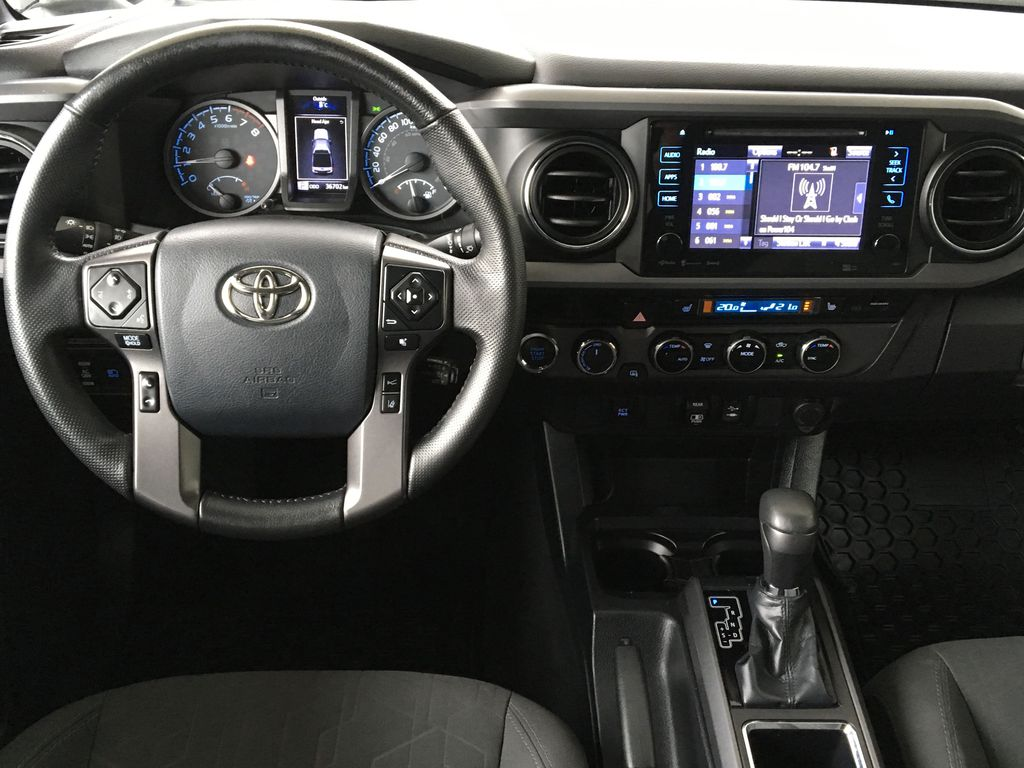 Gray[Cement Grey Metallic] 2018 Toyota Tacoma TRD Off Road Steering Wheel and Dash Photo in Kelowna BC