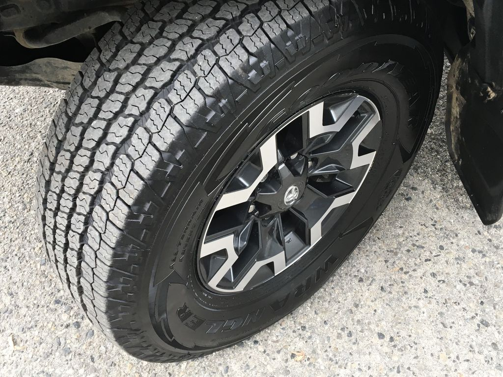 Gray[Cement Grey Metallic] 2018 Toyota Tacoma TRD Off Road Left Front Rim and Tire Photo in Kelowna BC