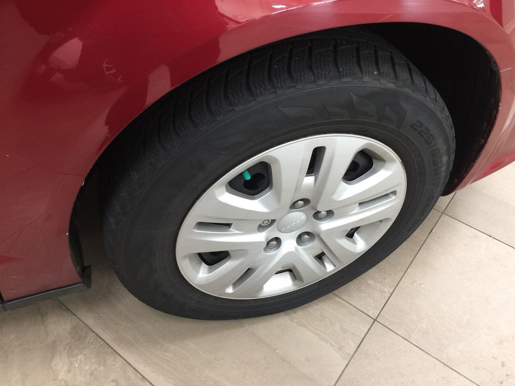 Red[Deep Cherry Red Crystal Pearl] 2016 Dodge Grand Caravan CVP Right Front Rim and Tire Photo in Sherwood Park AB