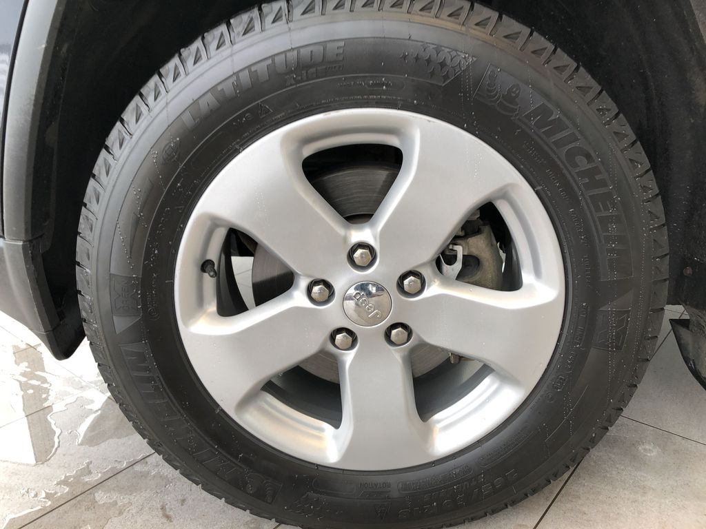 Blue[True Blue Pearl] 2013 Jeep Grand Cherokee Left Front Rim and Tire Photo in Edmonton AB