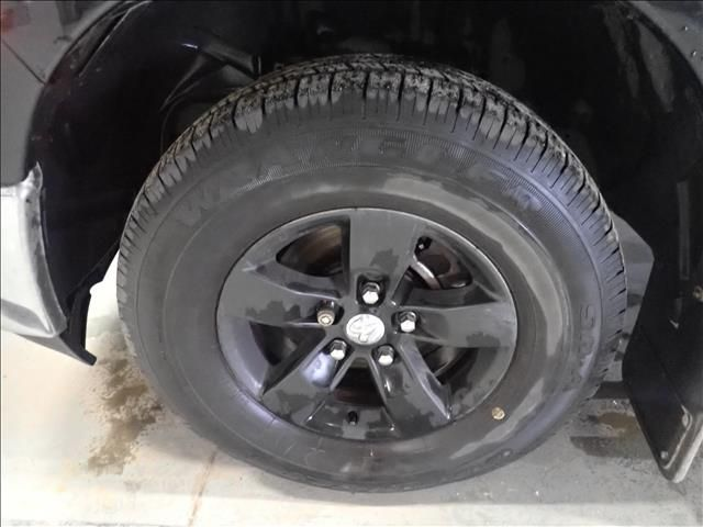 """Black 2018 Ram 1500 ST 4x4 Quad Cab 6'4"""" Box *Tow Package* Left Front Rim and Tire Photo in Brandon MB"""