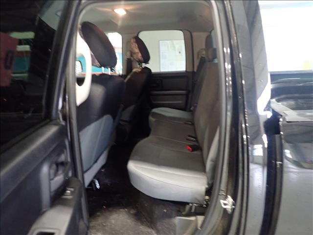 """Black 2018 Ram 1500 ST 4x4 Quad Cab 6'4"""" Box *Tow Package* Left Side Rear Seat  Photo in Brandon MB"""