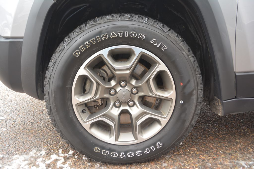 Silver 2020 Jeep Cherokee Left Front Rim and Tire Photo in Bonnyville AB