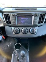 White 2015 Toyota RAV4 Strng Wheel/Dash Photo: Frm Rear in Brampton ON