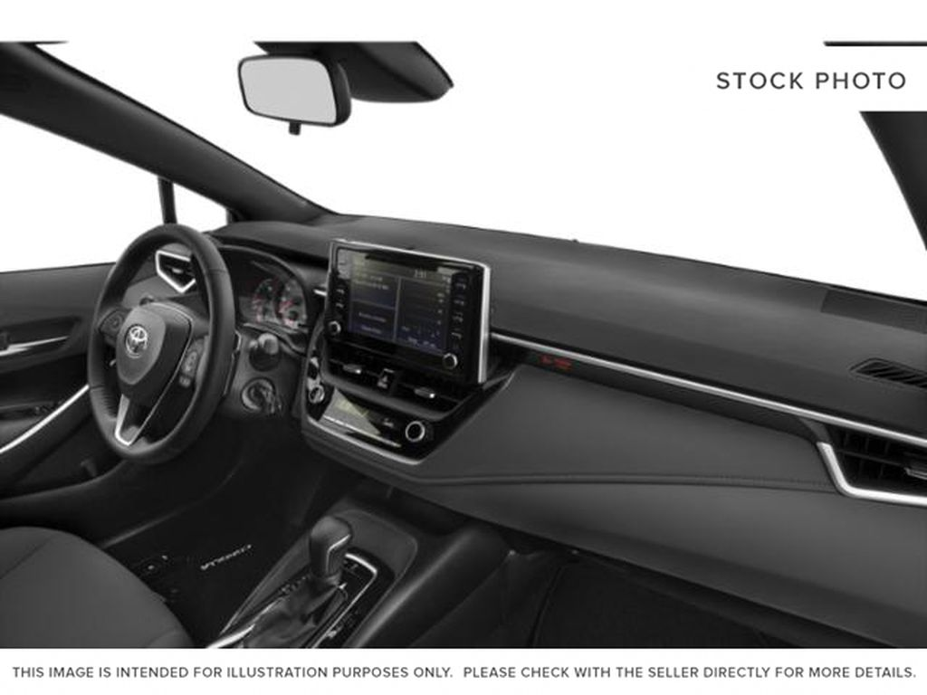 White[Blizzard Pearl] 2021 Toyota Corolla Steering Wheel and Dash Photo in Brockville ON