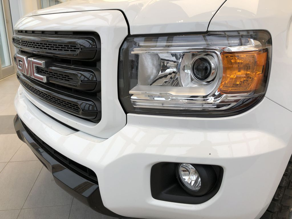 White[Summit White] 2020 GMC Canyon Left Front Head Light / Bumper and Grill in Edmonton AB