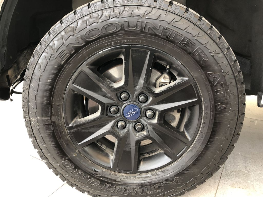 White[Oxford White] 2016 Ford F-150 Left Front Rim and Tire Photo in Edmonton AB
