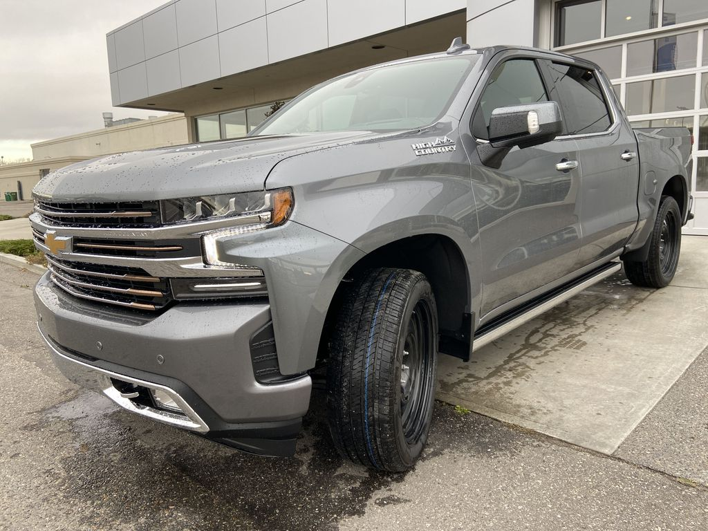 Gray[Satin Steel Metallic] 2021 Chevrolet Silverado 1500 High Country Left Front Head Light / Bumper and Grill in Calgary AB