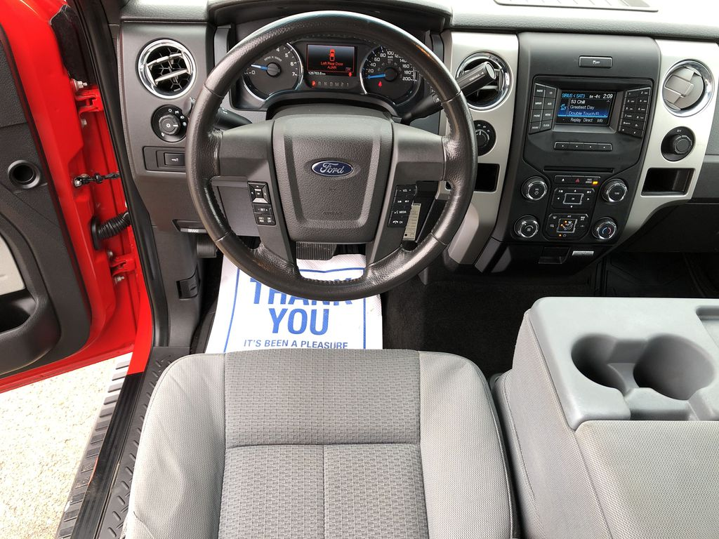 Red[Race Red] 2014 Ford F-150 Strng Wheel/Dash Photo: Frm Rear in Edmonton AB