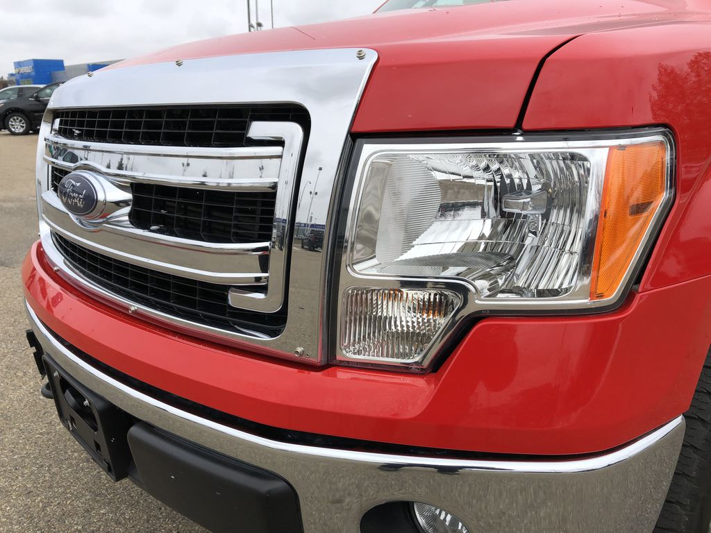 Red[Race Red] 2014 Ford F-150 Left Front Head Light / Bumper and Grill in Edmonton AB