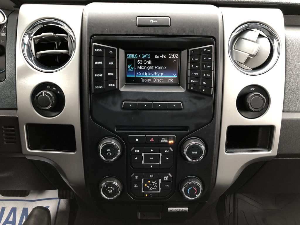 Red[Race Red] 2014 Ford F-150 Central Dash Options Photo in Edmonton AB
