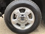 Red[Race Red] 2014 Ford F-150 Left Front Rim and Tire Photo in Edmonton AB