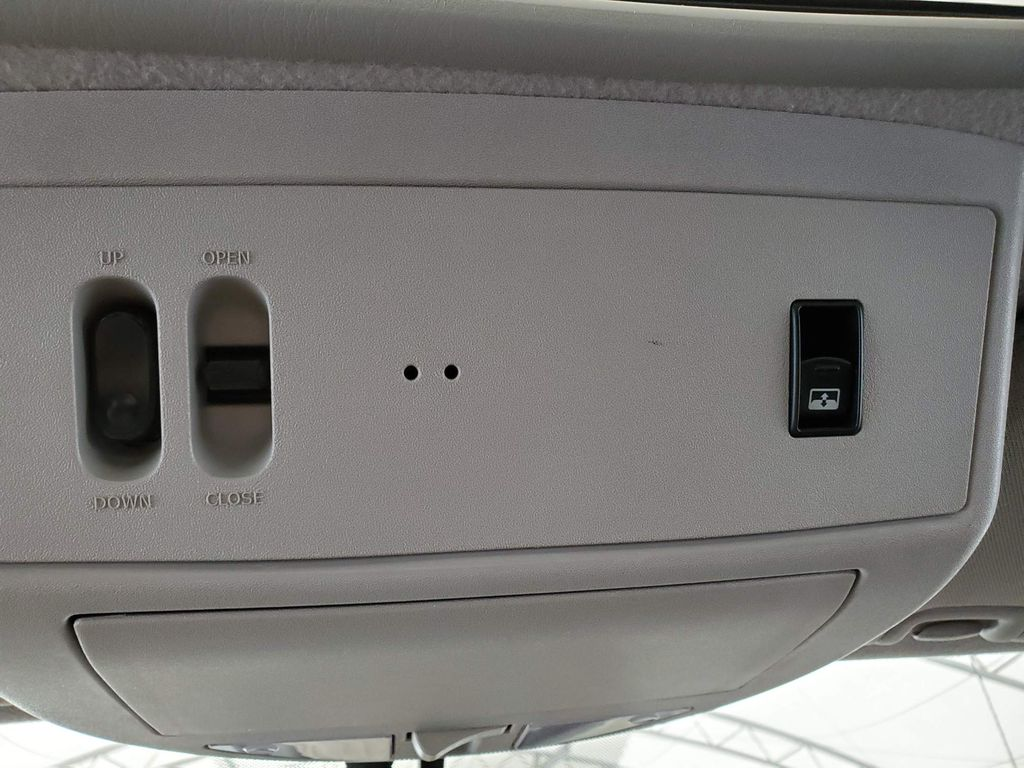 White 2014 Nissan Titan Central Dash Options Photo in Airdrie AB