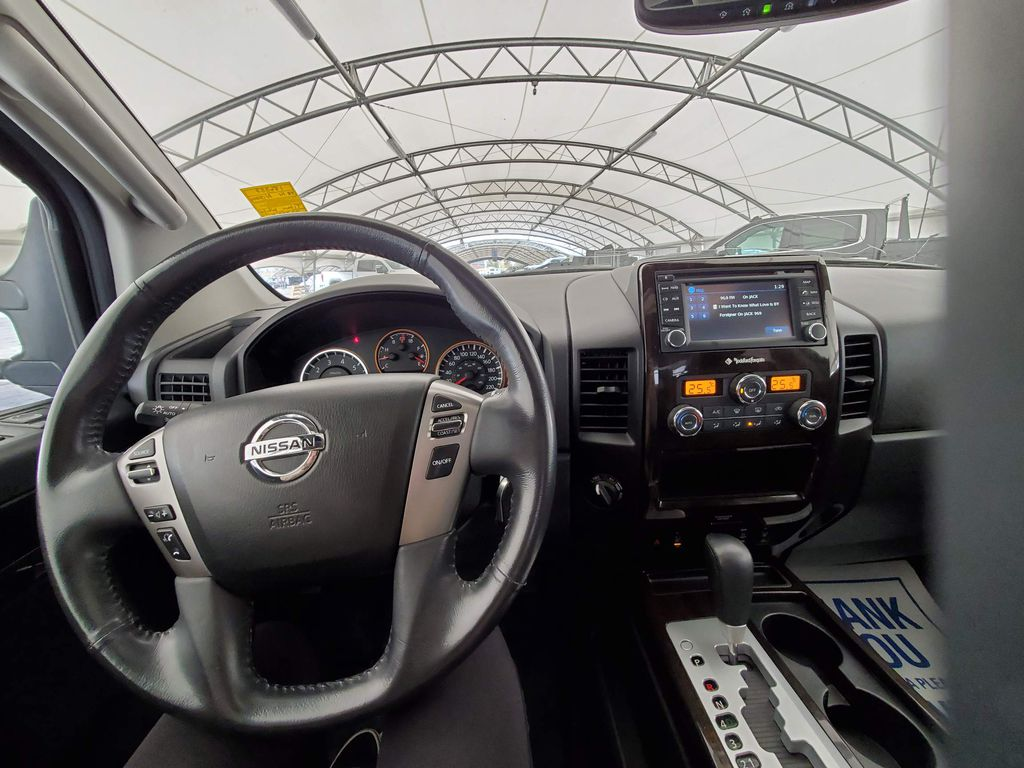 White 2014 Nissan Titan LR Door Panel Ctls Photo in Airdrie AB