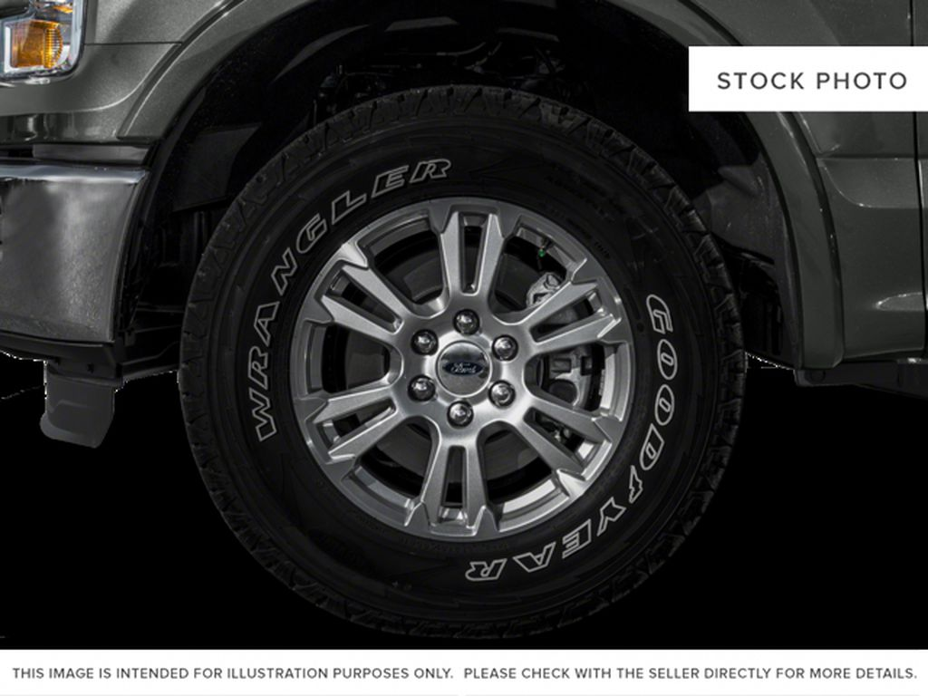 White[Oxford White] 2016 Ford F-150 Left Front Rim and Tire Photo in Fort Macleod AB