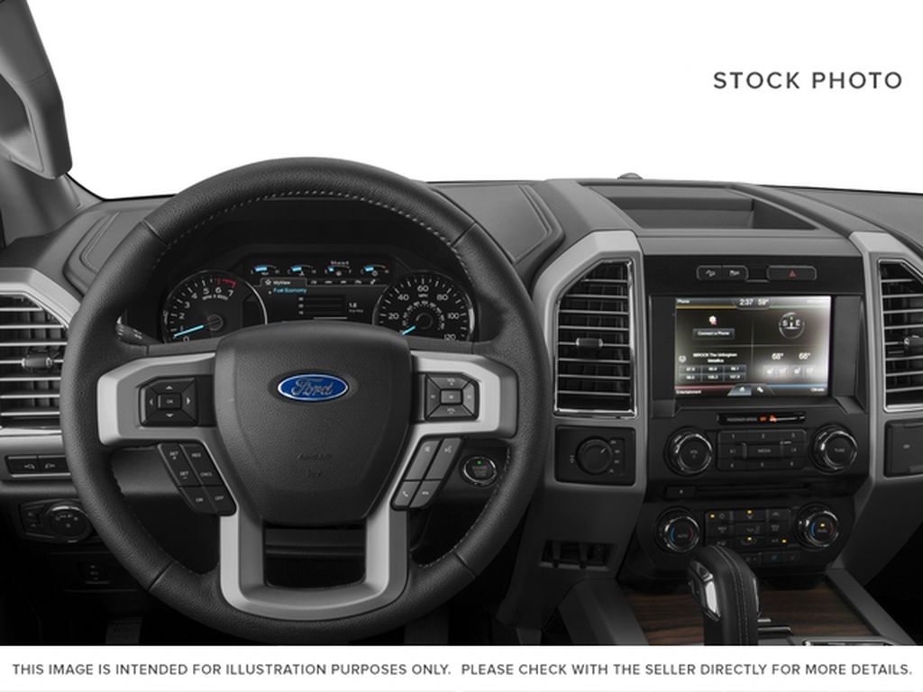 White[Oxford White] 2016 Ford F-150 Steering Wheel and Dash Photo in Fort Macleod AB