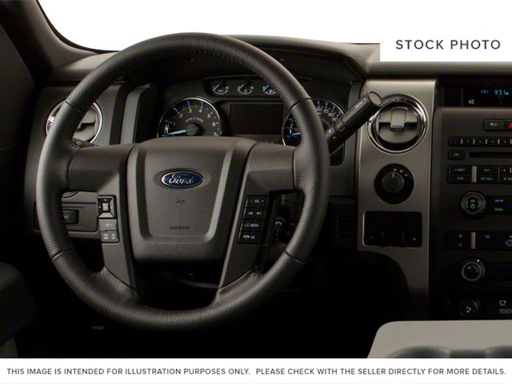 Black[Tuxedo Black] 2012 Ford F-150 Steering Wheel and Dash Photo in Fort Macleod AB