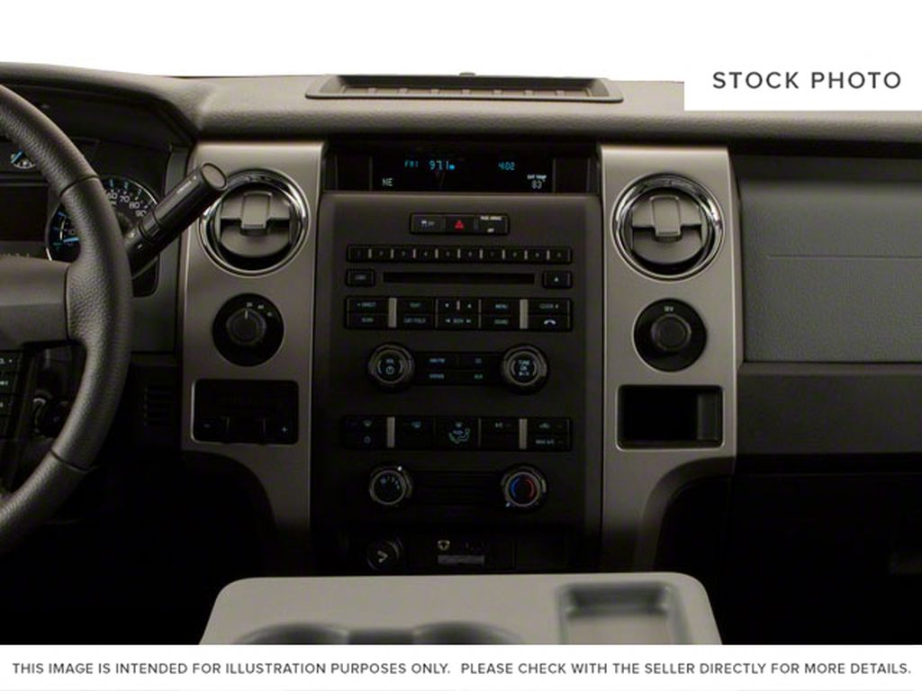 Black[Tuxedo Black] 2012 Ford F-150 Central Dash Options Photo in Fort Macleod AB