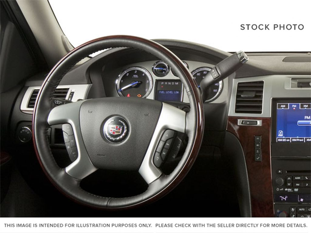 Black[Black Ice Metallic] 2011 Cadillac Escalade Steering Wheel and Dash Photo in Fort Macleod AB