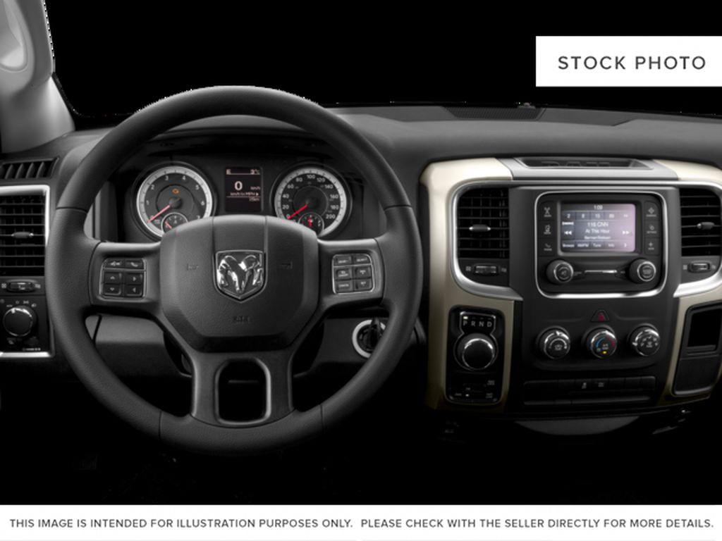 Silver[Bright Silver Metallic] 2016 Ram 1500 Steering Wheel and Dash Photo in Fort Macleod AB