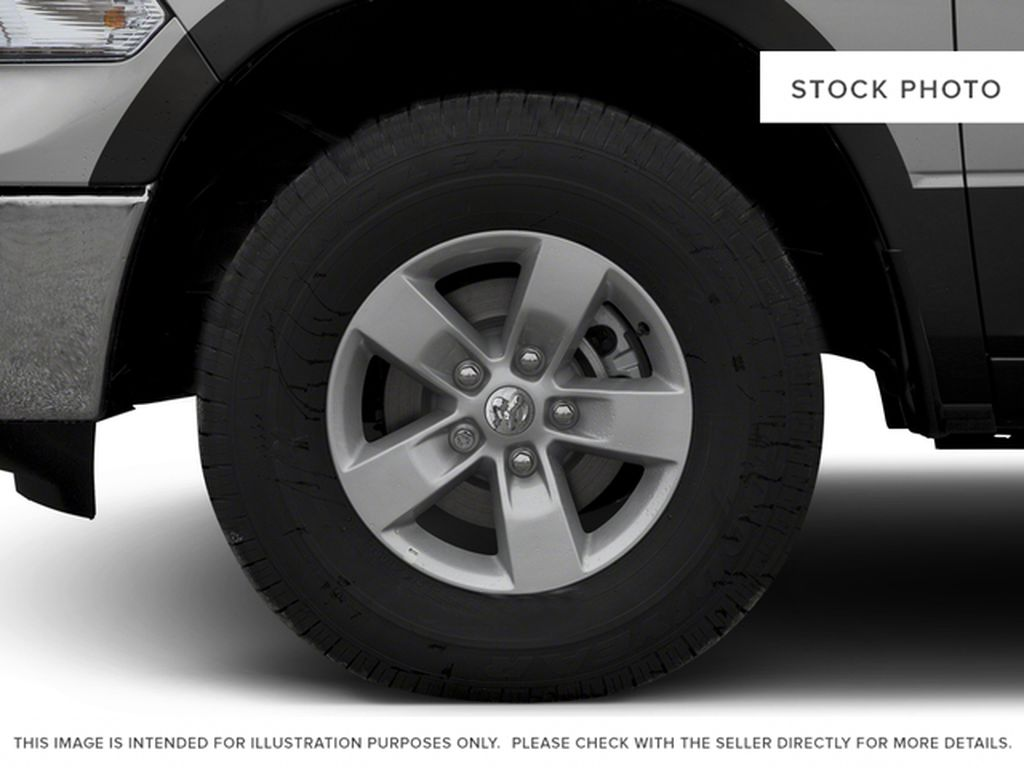 Silver[Bright Silver Metallic] 2016 Ram 1500 Left Front Rim and Tire Photo in Fort Macleod AB