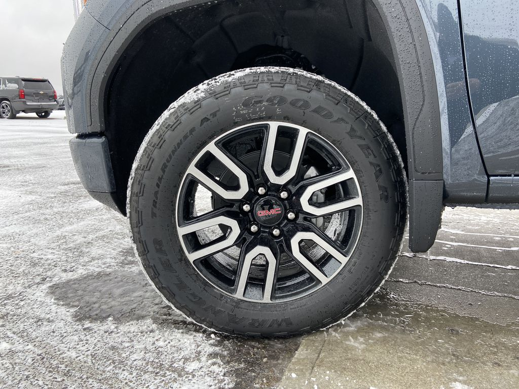 Gray[Satin Steel Metallic] 2021 GMC Sierra 1500 AT4 Left Front Rim and Tire Photo in Calgary AB