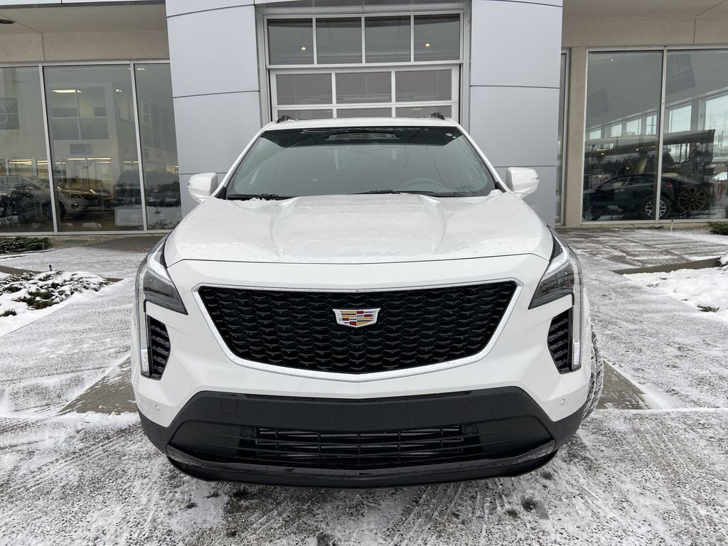 White[Crystal White Tricoat] 2021 Cadillac XT4 Sport Front Vehicle Photo in Calgary AB