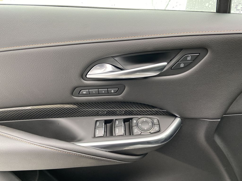 White[Crystal White Tricoat] 2021 Cadillac XT4 Sport  Driver's Side Door Controls Photo in Calgary AB