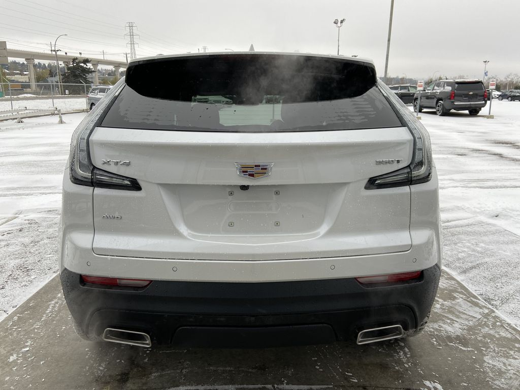 White[Crystal White Tricoat] 2021 Cadillac XT4 Sport Rear of Vehicle Photo in Calgary AB