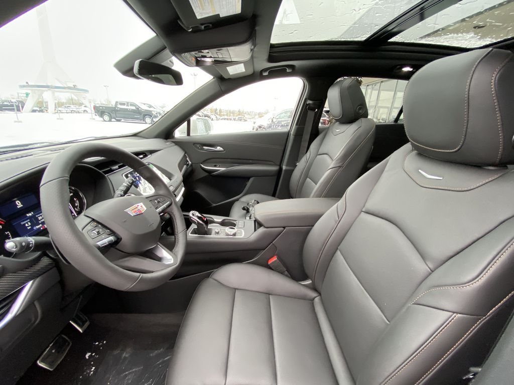 White[Crystal White Tricoat] 2021 Cadillac XT4 Sport Left Front Interior Photo in Calgary AB