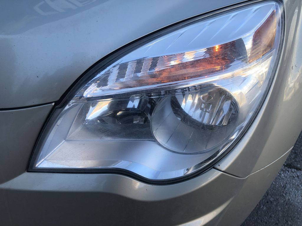 Gold[Champagne Silver Metallic] 2013 Chevrolet Equinox Left Front Head Light / Bumper and Grill in Canmore AB