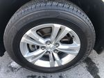 Gold[Champagne Silver Metallic] 2013 Chevrolet Equinox Left Front Rim and Tire Photo in Canmore AB