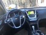 Gold[Champagne Silver Metallic] 2013 Chevrolet Equinox Strng Wheel/Dash Photo: Frm Rear in Canmore AB