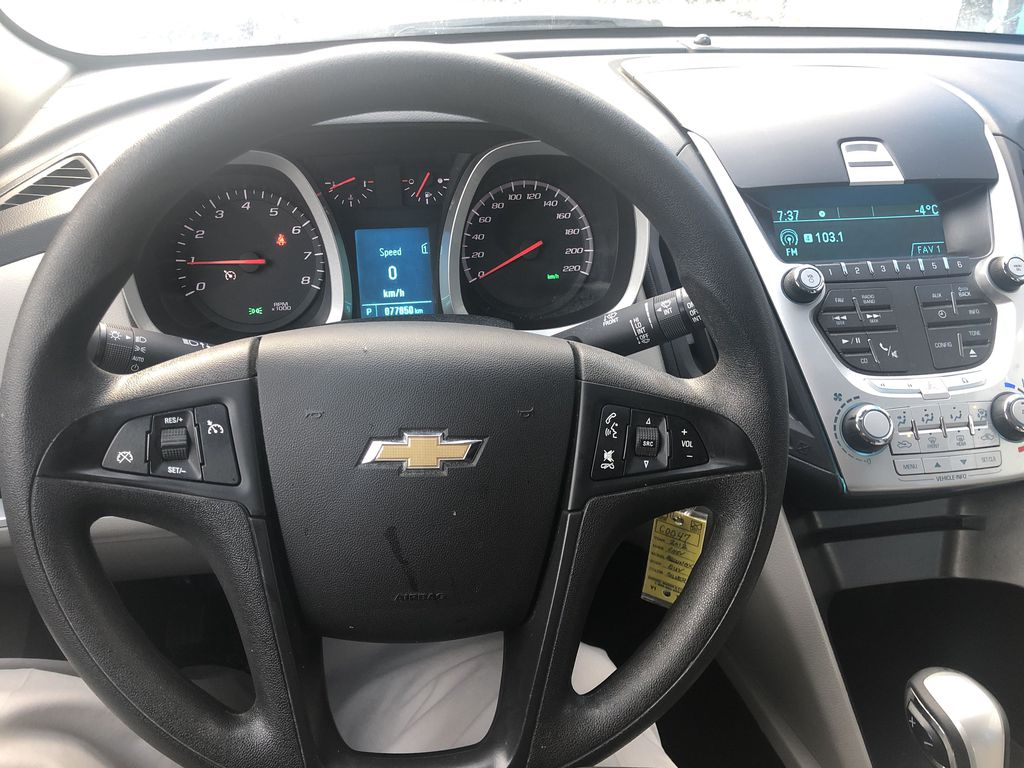Silver[Silver Ice Metallic] 2012 Chevrolet Equinox LS Steering Wheel and Dash Photo in Canmore AB