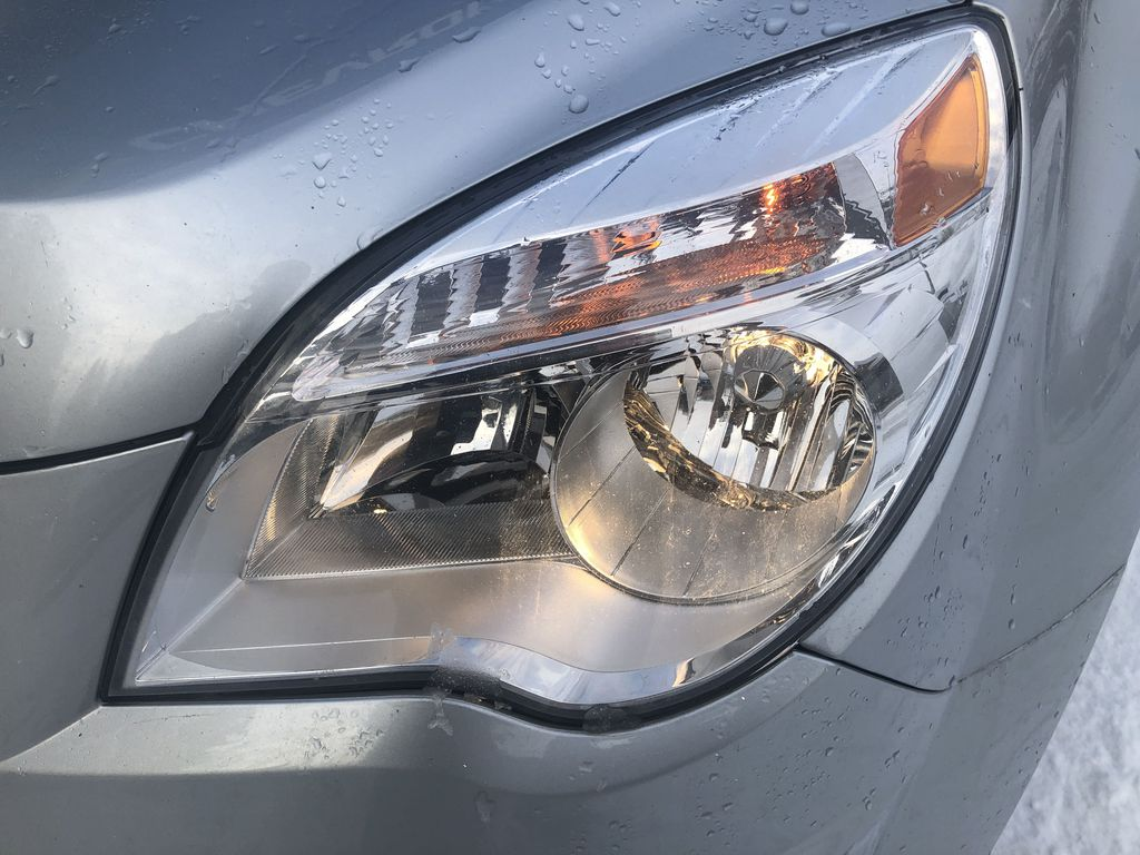 Silver[Silver Ice Metallic] 2012 Chevrolet Equinox LS Left Front Head Light / Bumper and Grill in Canmore AB