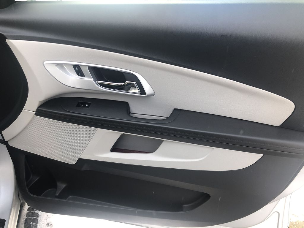 Silver[Silver Ice Metallic] 2012 Chevrolet Equinox LS Right Front Interior Door Panel Photo in Canmore AB