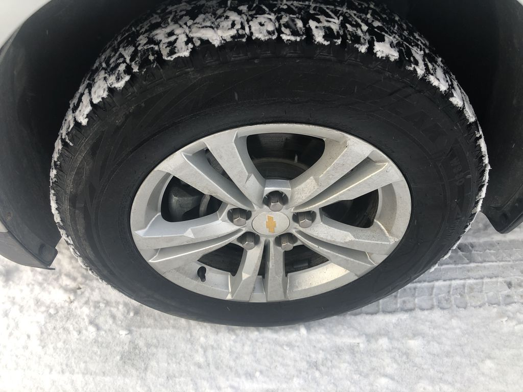 Silver[Silver Ice Metallic] 2012 Chevrolet Equinox LS Left Front Rim and Tire Photo in Canmore AB